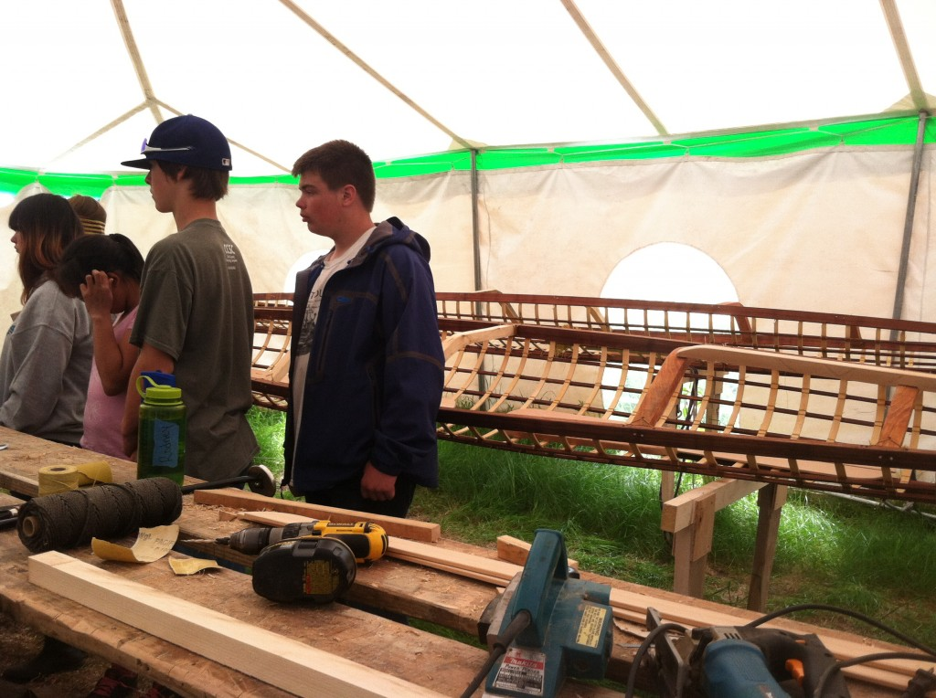 The campers on day 1 getting an intro to the tools used to make the traditional skin boats.